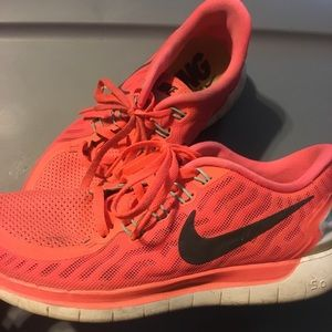 Nike 5.0 running shoe in a coral orange color.